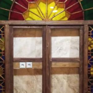 ساخت در و پنجره چوبی سنتی گره چینی